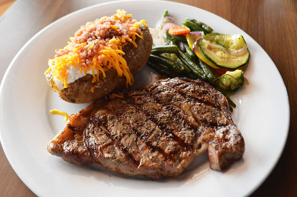 Ribeye with sides.jpg