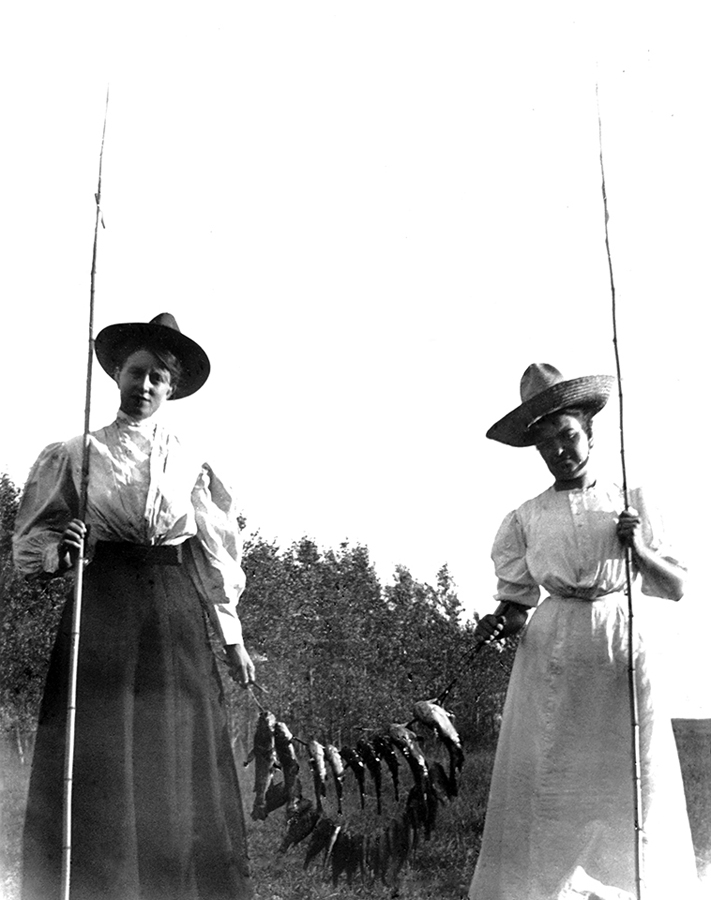 1012-Sub-Neg-26101,-2-unidentified-women-with-fishing-poles-and-string-of-fish-between-them-dura